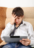 Troubled Teenager with Tablet Stock Image
