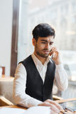 Troubled trader. Modern trader or broker talking by smartphone Stock Photography