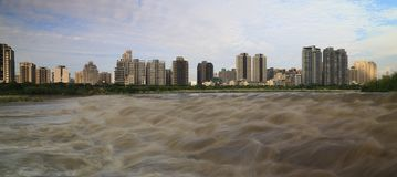 Troubled Water and City Landscape Royalty Free Stock Photo