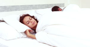 Troubled woman can't sleep. While man is sleeping stock video footage