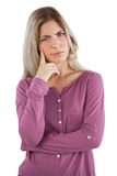Troubled woman with hand on chin Royalty Free Stock Image