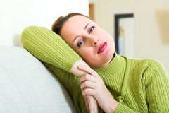 Troubled woman at home Royalty Free Stock Image