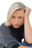 Troubled woman looking at camera Royalty Free Stock Photography