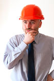 Troubled worker. In red helmet on white background Stock Image