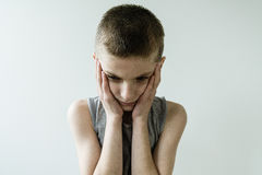 Troubled Young Boy with Head and Hands stock images
