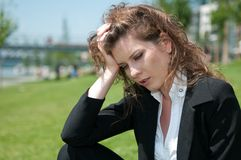 Troubled young business woman Royalty Free Stock Photos