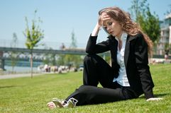 Troubled young business woman Stock Images