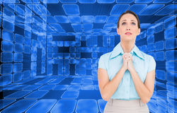 Troubled young businesswoman praying Royalty Free Stock Image