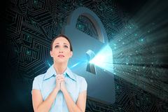 Troubled young businesswoman praying Royalty Free Stock Images