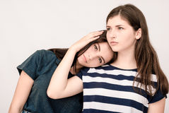 Troubled young girl comforted by her friend Stock Photo