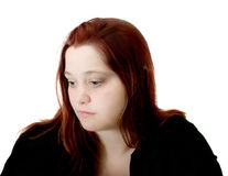 Troubled young woman. Troubled young red headed woman Stock Photos