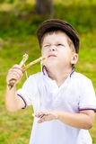 Troublemaker. Boy with slingshot Stock Images
