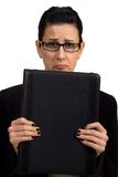 Troubles. Female holding briefcase looking troubled royalty free stock photo