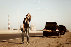 Fashion woman calling on the phone at the car Royalty Free Stock Photos