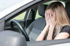 In troubles - unhappy woman in car Stock Photos