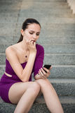 Troubles - young woman with phone Stock Images