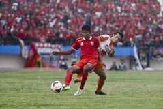 TROUBLESOME INDONESIAN SOCCER WORLD. A soccer match between Indonesian Premiere League football clubs Persis Solo and PSCS Cilacap at Manahan Stadium, Solo, Java Royalty Free Stock Photography