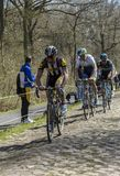 Three Cyclists in The Forest of Arenberg- Paris Roubaix 2015 stock photo