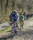 Two Cyclists in The Forest of Arenberg- Paris Roubaix 2015 stock photography