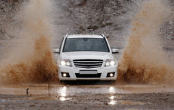 Trough the water. Sports SUV in the off road driving trough the water Royalty Free Stock Image