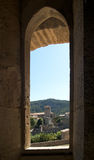 Trough the window. Village of Lagrasse through a window of the Abbey Royalty Free Stock Image