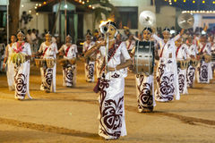 A troupe of female musicians perform during the Kataragama Festival in Sri Lanka. Royalty Free Stock Image