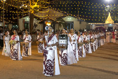 A troupe of female musicians perform during the Kataragama Festival in Sri Lanka. Stock Photos