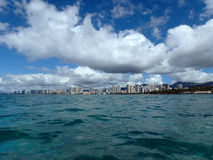 Trouquise Waters of Waikiki with Beach adn Hotels in view. Historic Natatorium, Waikiki, Condominiums, Honolulu cityscape and San Souci Beach, coconut trees and Stock Photography