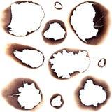 Trous brûlés en livre blanc Photographie stock libre de droits