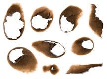 Trous brûlés en papier images stock