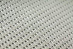 Trous dans la texture grise de mousse (pour le fond) Photo stock
