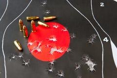 Trous de balle dans la cible Images libres de droits