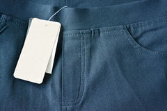 Trouser and blank label. Stock Images