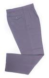 trousers calças em um fundo imagens de stock