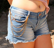 Trousers with chain jewellery Royalty Free Stock Photos