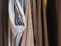 Trousers in a closet. Many male trousers hanging in a closet Royalty Free Stock Image