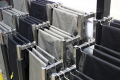 Trousers on hangers Stock Images