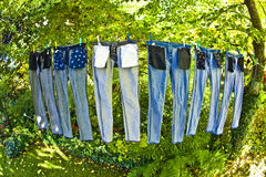 Trousers jeans outside on the clothes line Stock Photo