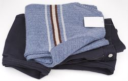 Trousers and jumper. Blue color stock photography