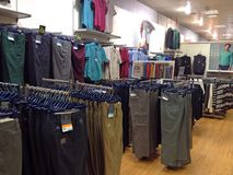 Trousers or pants on sale in a store. Stock Photography
