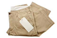 Trousers with tagging. Khaki Trousers with tagging isolated stock images