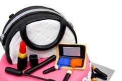 Trousse de maquillage faite de gâteau avec des accessoires Photos stock