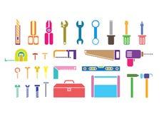 Trousses à outils colorées Images stock