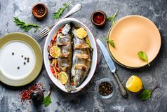 Trout with bacon and vegetables. Trout with bacon baked in the oven. Fish with vegetables royalty free stock photos