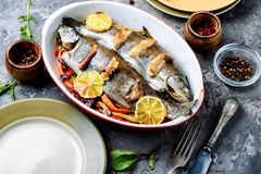 Trout with bacon and vegetables. Trout with bacon baked in the oven. Fish with vegetables stock images