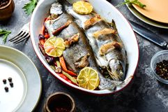 Trout with bacon and vegetables. Trout with bacon baked in the oven. Fish with vegetables stock photo