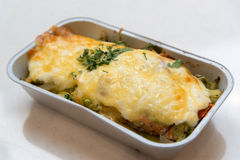 Trout baked with vegetables and cheese in batch trays Stock Photography