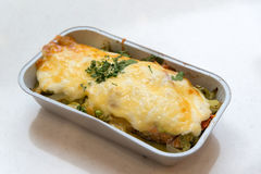 Trout baked with vegetables and cheese in batch trays Royalty Free Stock Image