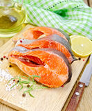 Trout on board with knife and napkin Royalty Free Stock Photo