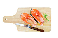 Trout on the board with a knife and rosemary Stock Images